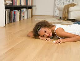 Beautiful lady laying on laminate flooring